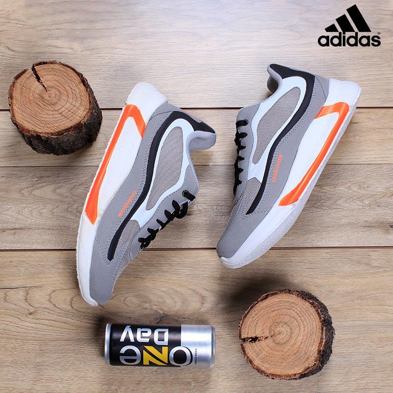 کفش مردانه adidasمدل ukabed( طوسی نارنجی)